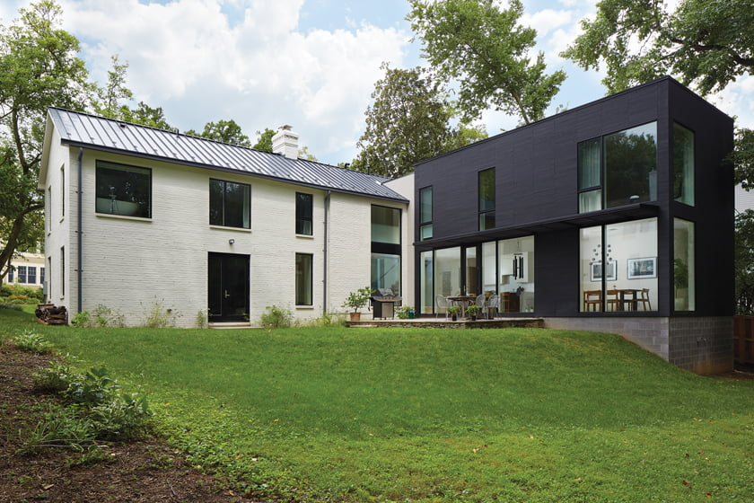 The renovation created an L-shaped design featuring a contemporary, cedar-clad wing.