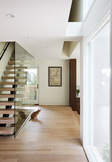 The new stairway leads to the second-floor bedrooms, where the hallway contain openings that admit daylight below.