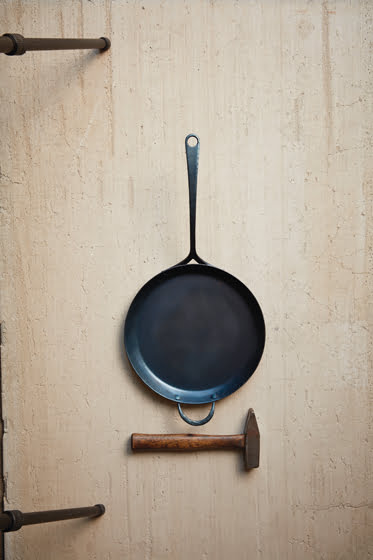 Seasoned with coconut oil, finished skillets develop a blue-black patina. © Adam Ewing