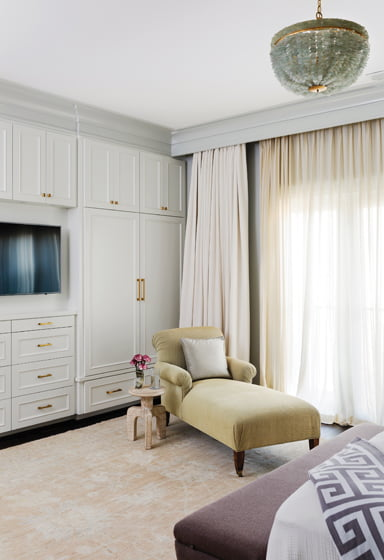 A comfy chaise and an Oushak carpet in the master suite were sourced through Pasargad.
