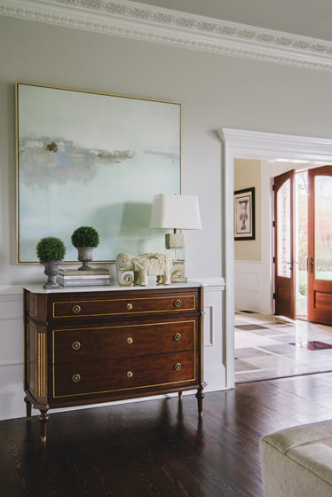 A Lillian August chest occupies the entrance to the living room.