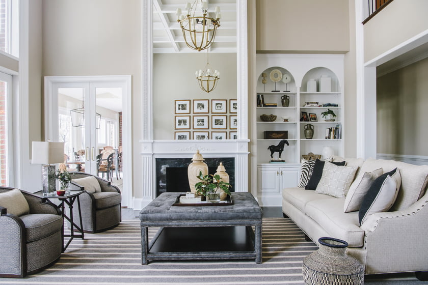 The facing arrangement features a Wesley Hall sofa upholstered in Perennials fabric.