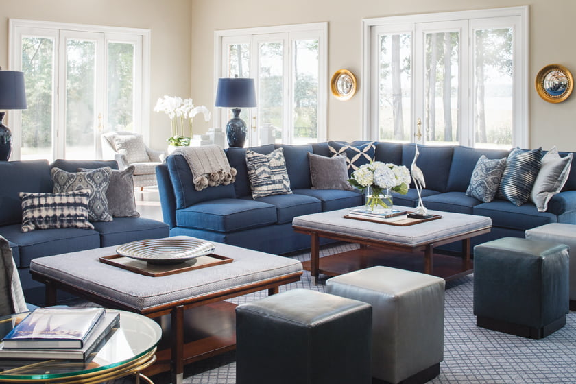 The Stanton Furniture rug is timeless in navy and white; leather cube ottomans provide extra seating.