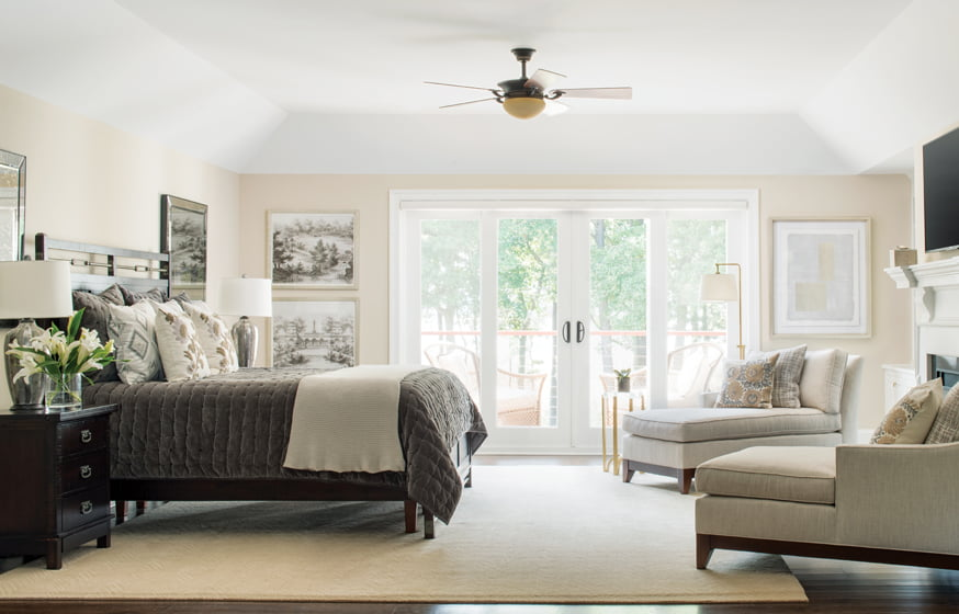 The master bedroom opens onto a balcony with water views.