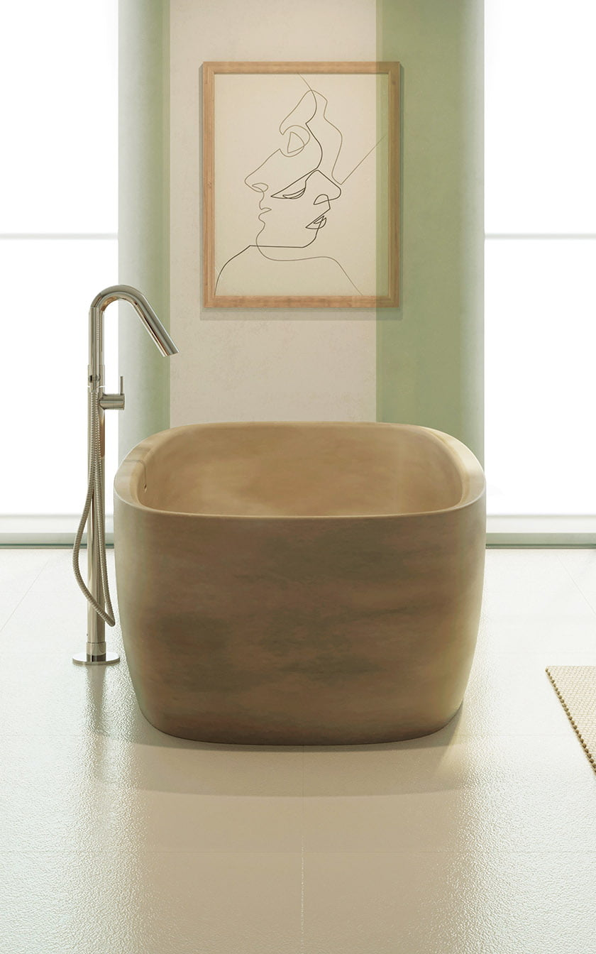 Aquatica Baths' Colette Freestanding Solid Surface Bathtub, pictured in concrete, is a luxurious addition to a sleek, modern bath.