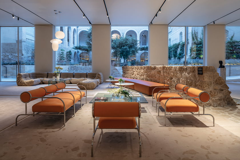 While the hotel is housed in a restored 19th-century hospital, the lobby reveals remnants of a 13th-century Crusader's wall. © Amit Geron