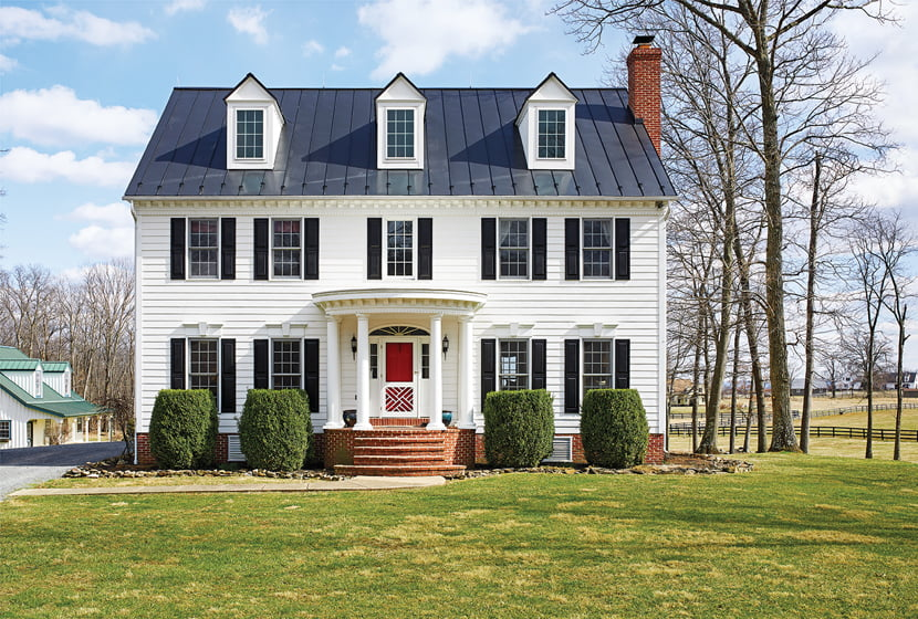 From the outside, the traditional home on rolling pastureland has a stately bearing.