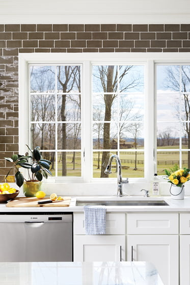 Three newly installed windows admit light and picturesque views.