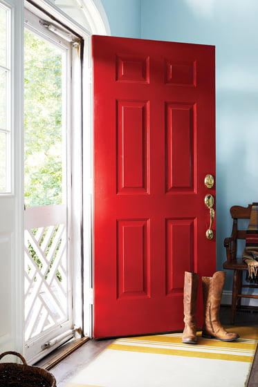 A bright-red front door ushers guests into the foyer.