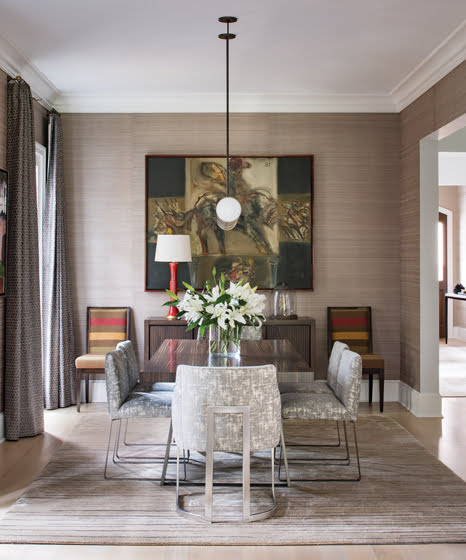 A painting by Ruben Alterio hangs above the sideboard in the dining room.