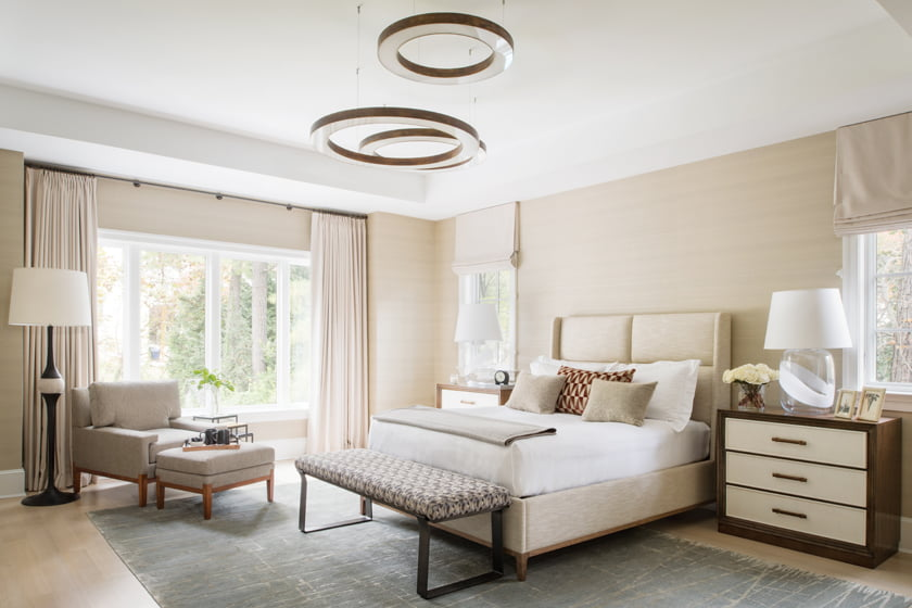 The master bedroom features a Cameron House light fixture, a Stark carpet and a chaise and ottoman by Hickory Chair.
