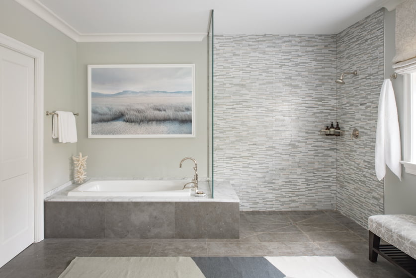 The serene vibe carries over into the master bath.