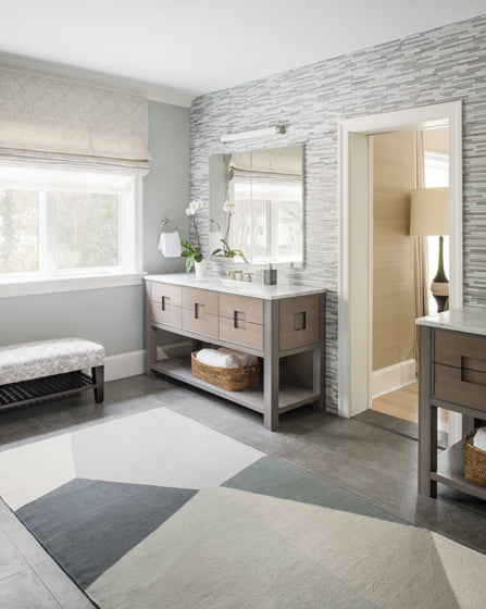Vicas combined Ann Sacks flooring and wall tiles with custom vanities and fixtures by Waterworks.