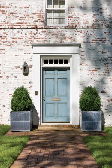 The front door's custom blue hue inspired the interior palette.