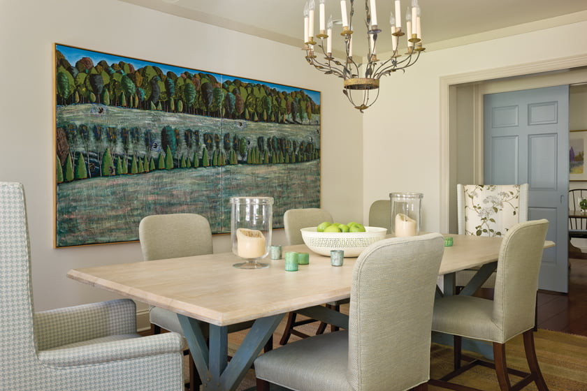 A landscape by John Borden Evans commands one wall of the dining room, which features a Richard Mulligan table.