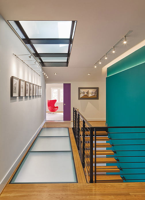 Daylight filters from the second floor to the basement via glass ceiling and floor panels and an open staircase.