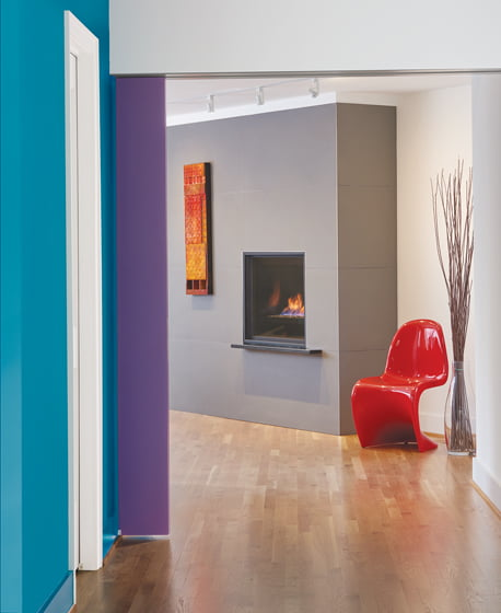 A minimalist fireplace replaced a clunky, dated one in the study at the rear of the house.
