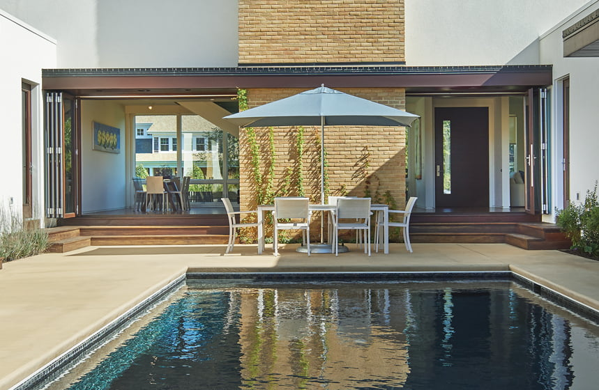 Folding NanaWalls seamlessly connect the pool courtyard to the main living space.
