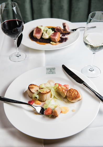 Day boat scallops and duck breast at The Alexander Brown Restaurant. © Amy Pezzicara