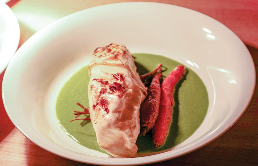 Cabbage-wrapped grilled halibut at Chez Hugo. © Marquette Shaw