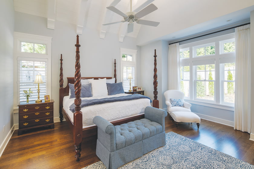The master suite features a bedroom in peaceful shades of blue.