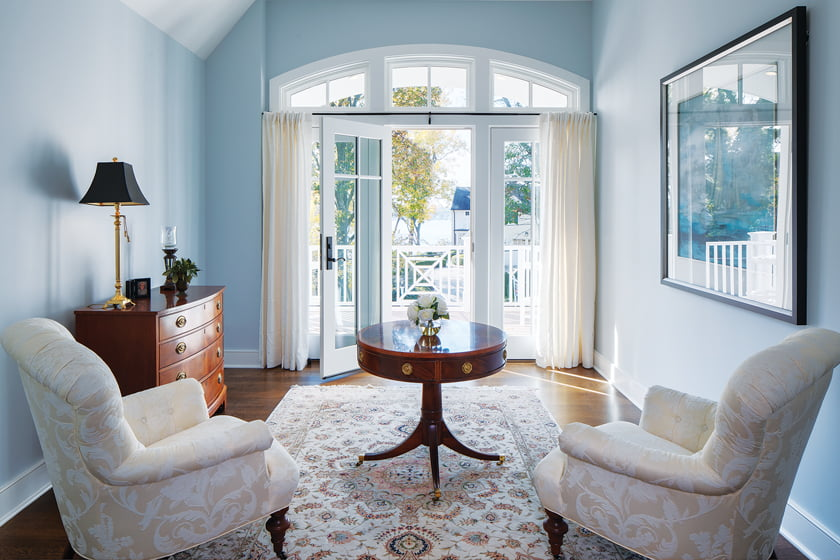 The second-floor sitting area opens to a balcony with a view of the Severn River.