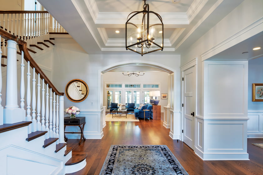 The entry foyer features a Circa Lighting lantern.