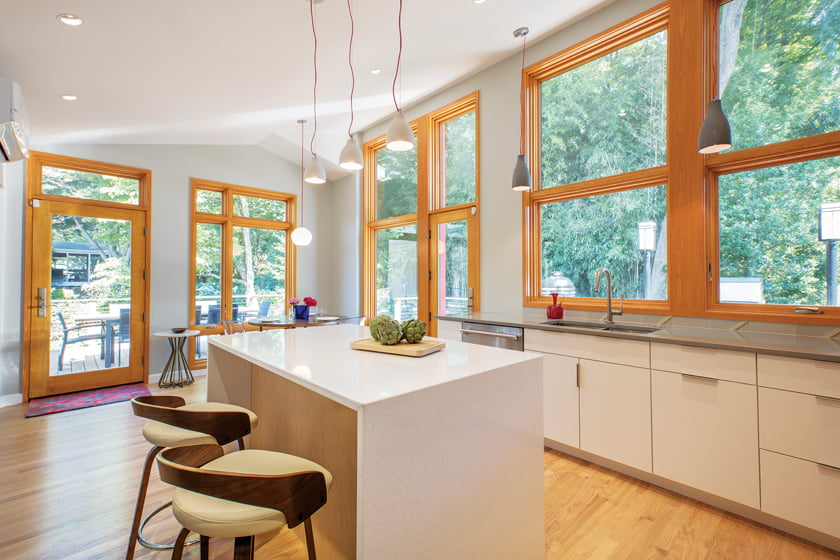 The new kitchen centers on an island with a quartz waterfall countertop.