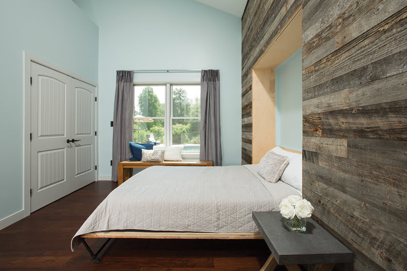 The wall conceals a Murphy bed.