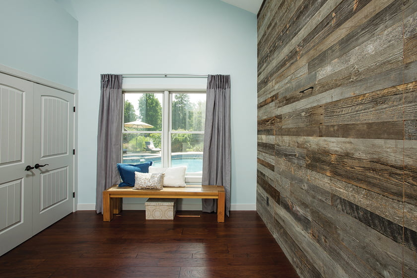 The guest suite boasts a reclaimed-wood accent wall.