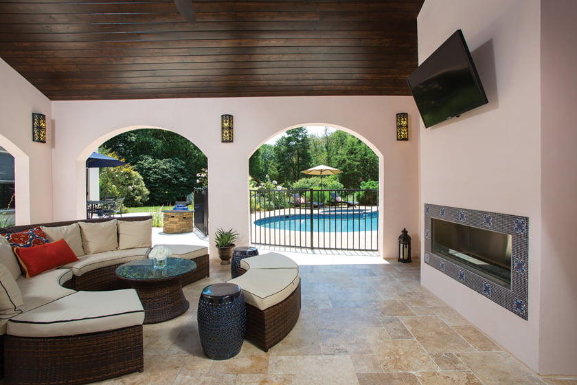 The adjacent pavilion features comfortable seating and a fireplace.