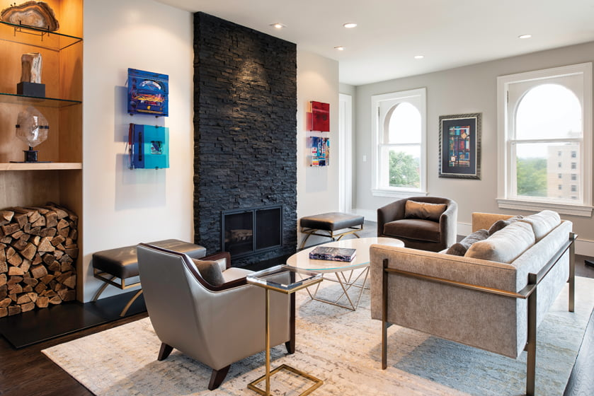"""A fireplace """"tower"""" of dry-stacked quartzite brings scale and proportion to the main wall in the open living area."""