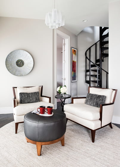 An adjacent grouping features Baker chairs in Zinc fabric.