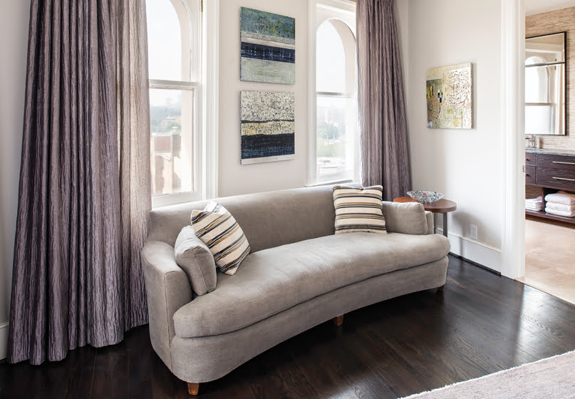 In the master suite, a sofa and drapes—both in Romo fabrics—help de-emphasize the angled wall.