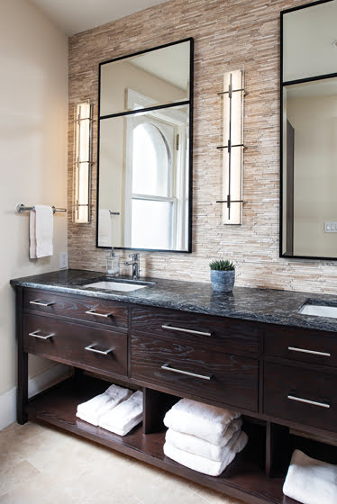 In the spacious master bathroom, oversized mirrors and sconces are scaled to fit the Hardwood Artisans vanity.
