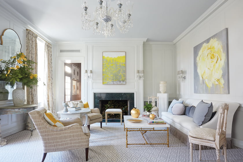 A Wolf Kahn painting over the living room fireplace introduces the yellow-gold hue that connects the interior spaces.