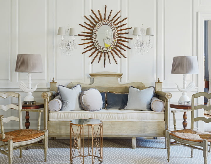 Molster's old-meets-new approach pairs an antique Swedish settée with whimsical lamps from Global Views.