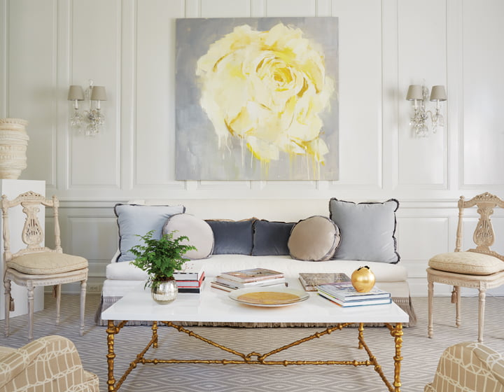 In the living room, a painting by Atlanta artist Susie Pryor hangs above a sofa from Lee Industries and a Oly Studio coffee table.