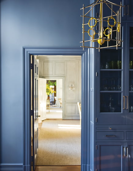 Color turns bold in the butler's pantry, painted in Benjamin Moore's Mineral Alloy.