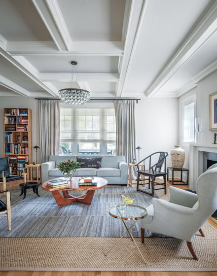 Furnishings in the living room mix styles and eras. © Jaime Harris
