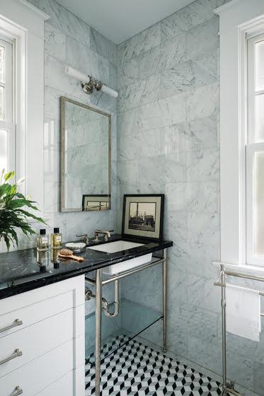 Bold, geometric floor tile enhance the marble-clad master bathroom. © Jaime Harris