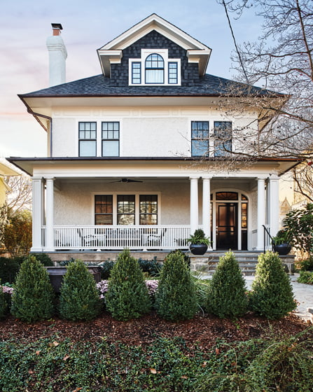 The remodeled home reveals its original stucco exterior and newly restored front porch. © Stacy Zarin Goldberg