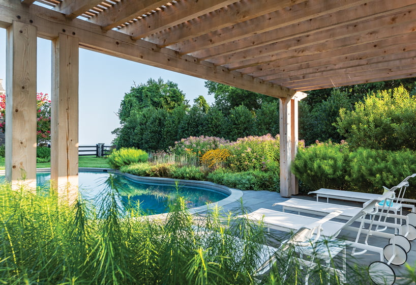 A pergola frames views of the bay in a critical-area project in Tolchester, Maryland, by South Fork Studio Landscape Architecture.