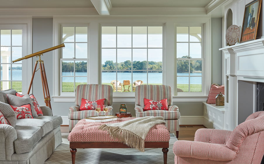 In a great room, Stephanie Simmons of Karen Renée Interior Design left the windows free of draperies to emphasize the view.