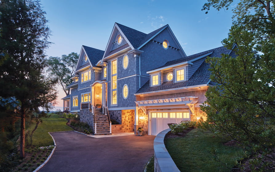 Bayview Builders weather-proofed this Shingle-style Annapolis home with NuCedar synthetic shingle siding over a Benjamin Obdyke HomeSlicker rainscreen.