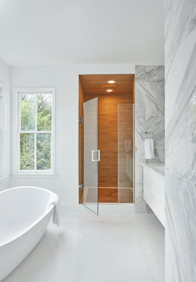 In the master bath the tile, cabinets, tub and plumbing fixtures are from Porcelanosa.
