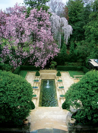 The lush landscape, inspired by English gardens, creates a private refuge on Whitehaven Street.