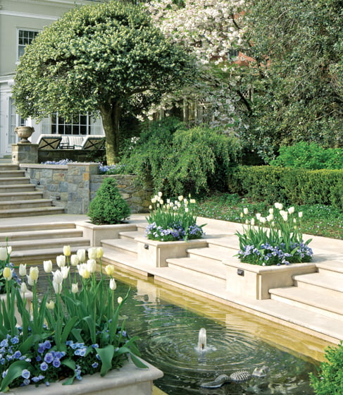 An existing upper terrace was imbued with drama by a second flight of steps leading to the sunken fountain pool.