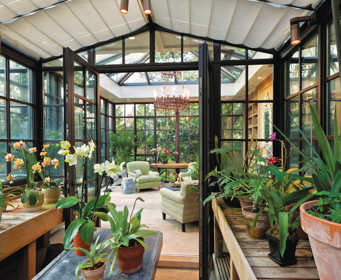 """A greenhouse off the new garden """"living room"""" accommodates the owner's orchid collection."""