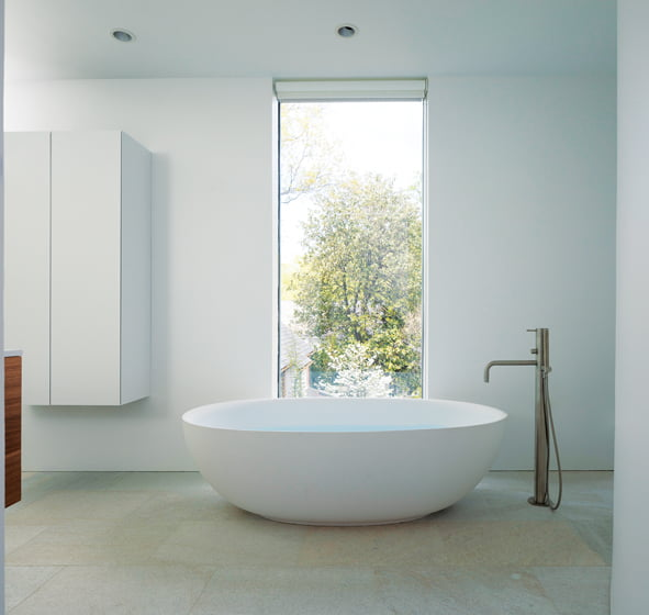 During the recent renovation, Jameson created a new master bathroom outfitted with a Boffi soaking tub .